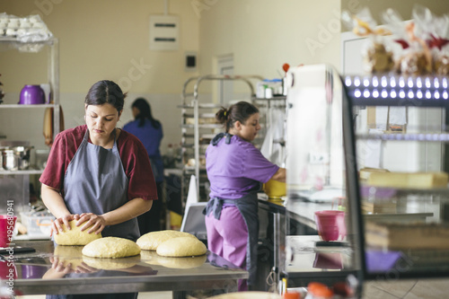 Preparing bread at the bakery