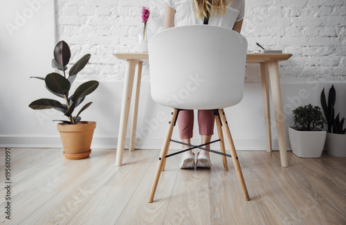 Woman Sitting at Her Home Office