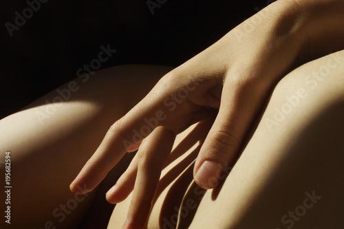 hand touching the body closeup