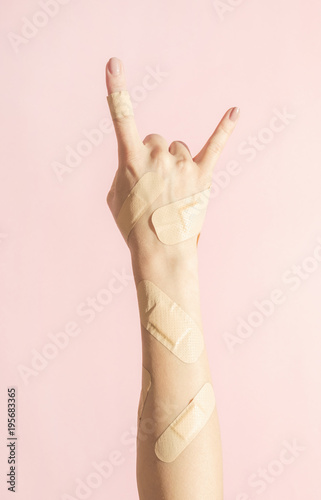Arm covered in adhesive bandages