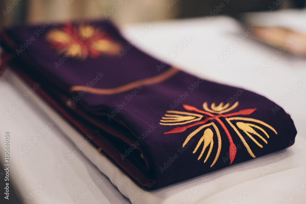 Fototapeta Clergy stole for priests and deacons. Selective focus. Copy space.