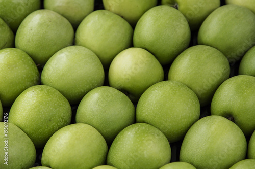 Green apples in a crate