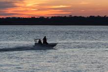 Silhouette Of Fishermen Heading Home