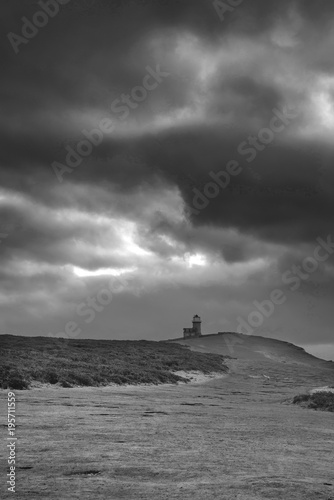 Fototapety, obrazy: Stunning black and white landscape image of Belle Tout lighthouse on South Downs National Park during stormy sky