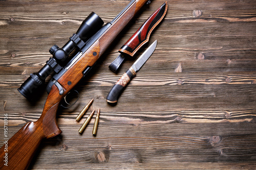 Hunting equipment on old wooden background. Canvas Print
