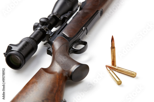 Valokuva Hunting rifle and ammunition isolated on white background