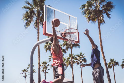 Two basketball players playing outdoor in LA Canvas Print