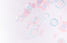 Abstract, Beautiful Pink Soap Bubbles Floating Background.