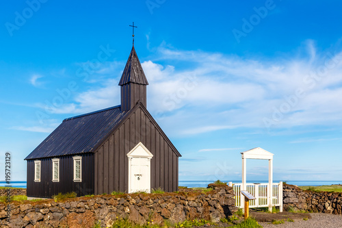 Cadres-photo bureau Edifice religieux Budakirkja black painted lutheran parish erected in 1847 with blue sky and clouds in the background, Snaefellsnes Peninsula, West Iceland