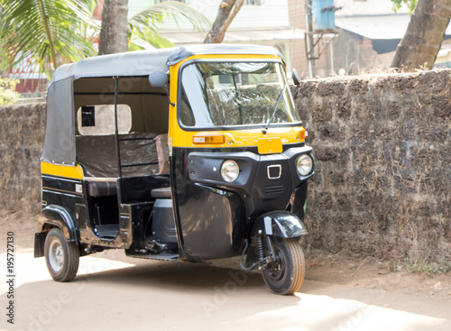 New rickshaw stands on the streets of India  The driver