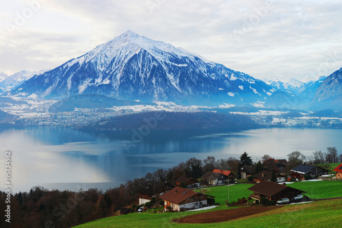 Tuinposter Blauwe jeans Sigrilwil village at Swiss Alpine mountains and Thun lake