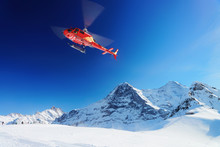 Red Helicopter Flying Swiss Al...