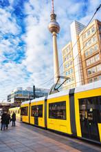 Running Tram On Alexanderplatz With Television Tower In Berlin