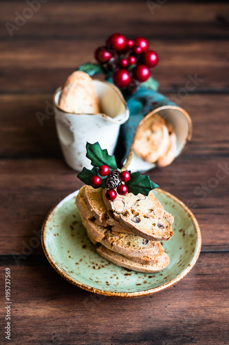 Staande foto Dessert Italian dry cookies cantucci or biscotti with almond nuts stacked on a dessert plate on a wooden table, selective focus. Image with copy space. Easter food.