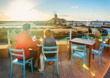 People At Street Restaurant At Salt Evaporation Pond Marsala Sicily