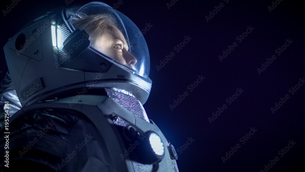 Fototapety, obrazy: Portrait of the Beautiful Female Astronaut Space Walking, Looking around in Wonder. Space Travel, Extraterrestrial Exploration and Solar System Colonization Concept.