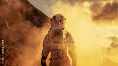 Courageous Astronaut in the Space Suit Explores Red Planet