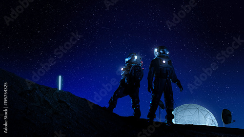 Fényképezés Two Astronauts in Space Suits Stand on the Moon Looking at the Beautiful Nght Sky Full of Stars