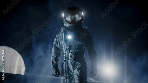 Courageous Astronaut in the Space Suit with Flashlight