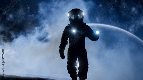 Fotografia  Courageous Astronaut in the Space Suit Holds Flashlight and Explores Mysterious Alien Planet Covered in Mist