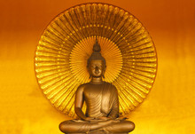 Golden Buddha Meditation With Gold Color Background.