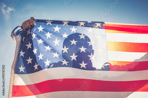 Photo  Man with American flag