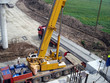 Truck transporting beams concrete