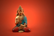 Buddha Statue Stock Images. Decorative Buddha On Red Background. Statue Of A Buddha