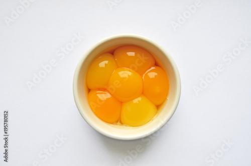 Egg yolks in white bowl