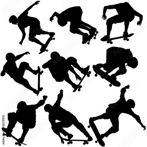 Fotografie, Obraz  Set black silhouette of an athlete skateboarder in a jump