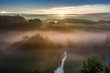 Sunrise at foggy valley in autumn, Poland