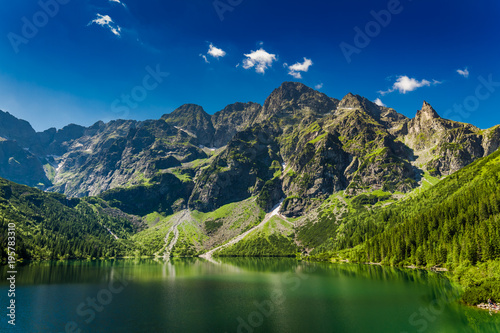Foto auf Leinwand Gebirge Famous big pond in the Tatra mountains at sunrise, Poland