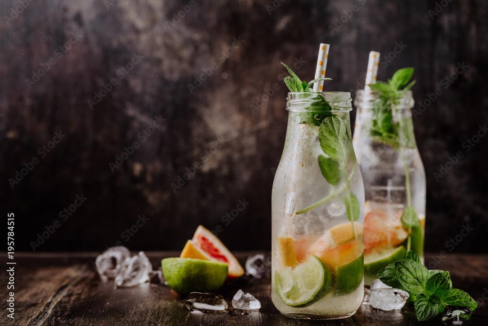 Fototapeta Glass bottles with fresh drink