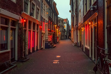 Red Light District In Amsterdam, The Netherlands, Night View. Windows And Doors Where Prostitutes Work
