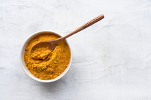 Golden Turmeric Powder And Woo...