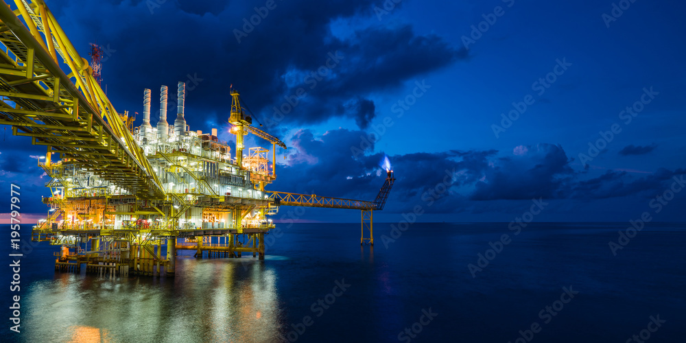 Fototapety, obrazy: Panorama of oil and gas central processing platform in sun set where produced, treat the hydrocarbon then sent to refinery , petrochemical , power generation plant and tanker barge for export.
