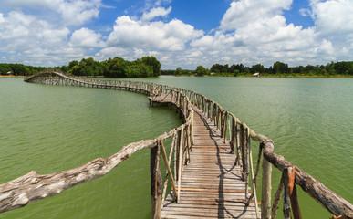 FototapetaWooden bridge across reservoir.