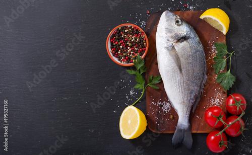 Foto op Plexiglas Vis fresh fish dorado with ingredients for cooking