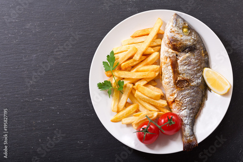 Fotografie, Obraz  plate of baked fish with french fries