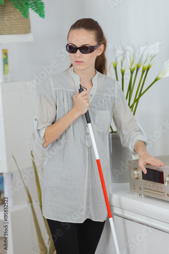 Valokuva  blind woman at home