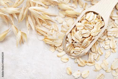 Oat groat in wooden spoon, oatmeal grain for healthy diet on oat