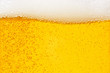 canvas print picture - Pouring beer with bubble froth in glass for background on front view wave curve shape