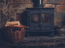 Log Burner With Basket Of Firewood