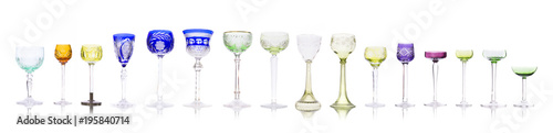 Collection of colorful crystal chalices and wineglasses isolated on white background