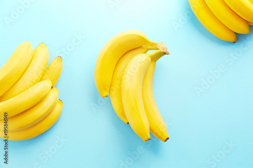 Yummy ripe bananas on color background