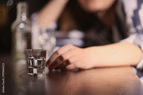 Fotografía Woman with glass of alcohol in bar
