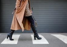 Stylish Woman In Black Shoes Walking Across The Street