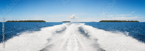 Fotografía  Background water surface behind of fast moving motor boat in vintage retro style