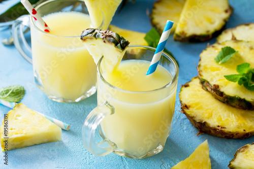 Foto op Aluminium Milkshake Homemade refreshing fruit beverage with pineapple, fresh vitamins. Cold summer drink.