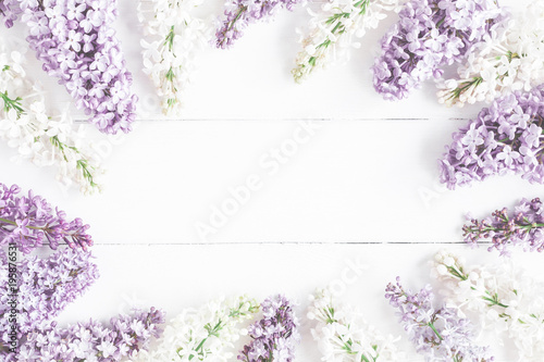 Fotobehang Lilac Flowers composition. Spring lilac flowers on white wooden background. Flat lay, top view, copy space